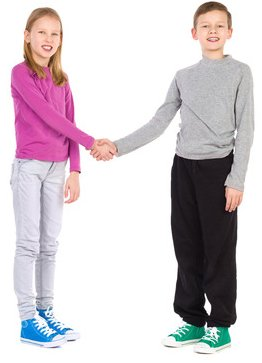 Boy and girl shaking hands